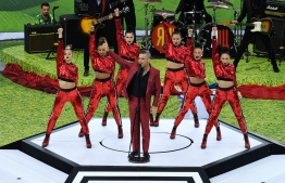 British singer Robbie Williams performs during the opening ceremony before the Russia 2018 World Cup Group A football match between Russia and Saudi Arabia at the Luzhniki Stadium in Moscow on June 14, 2018. / AFP PHOTO / Mladen ANTONOV /