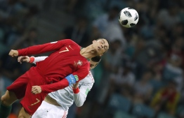 Portugal's forward Cristiano Ronaldo heads the ball during the Russia 2018 World Cup Group B football match between Portugal and Spain at the Fisht Stadium in Sochi on June 15, 2018. / AFP PHOTO / Odd ANDERSEN /