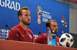 England's forward Harry Kane (L) and England's coach Gareth Southgate (R) give a press conference in Volgograd on June 17, 2018, on the eve of the Russia 2018 World Cup Group G football match between Tunisia and England.  / AFP PHOTO / Mark RALSTON