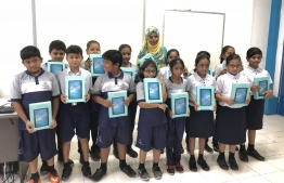 Some students of Dharumavantha School holding tablets. PHOTO/MIHAARU