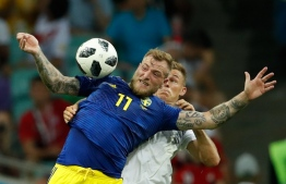 Sweden's forward John Guidetti (frony C) vies for the ball with Germany's defender Joshua Kimmich (rear C) during the Russia 2018 World Cup Group F football match between Germany and Sweden at the Fisht Stadium in Sochi on June 23, 2018. / AFP PHOTO / Odd ANDERSEN /