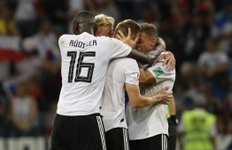 Germany's midfielder Toni Kroos (C) celebrates scoring the 2-1 goal with his teammates during the Russia 2018 World Cup Group F football match between Germany and Sweden at the Fisht Stadium in Sochi on June 23, 2018. According to 2019 figures, the German FA has 7.1 million members, with 149,735 registered teams playing in 24,544 clubs - the country's largest sports body. The potential bankruptcy has already begun to affect thousands of employees. PHOTO: AFP