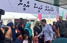 President Abdulla Yameen warmly welcomed by the residents of K. Thulusdhoo during his official trip to the island on June 24, 2018. PHOTO/PRESIDENT'S OFFICE