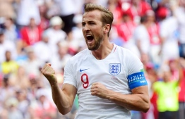 England's forward Harry Kane celebrates after scoring his team's fifth goal during the Russia 2018 World Cup Group G football match between England and Panama at the Nizhny Novgorod Stadium in Nizhny Novgorod on June 24, 2018. / AFP PHOTO / Martin BERNETTI /