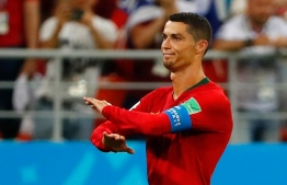 Portugal's forward Cristiano Ronaldo reacts during the Russia 2018 World Cup Group B football match between Iran and Portugal at the Mordovia Arena in Saransk on June 25, 2018. / AFP PHOTO / Jack GUEZ /