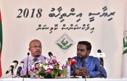 Elections Commission members during a press conference on the upcoming presidential elections.
