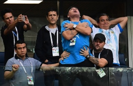 Former Argentina forward Diego Maradona (C) celebrates the opening goal during the Russia 2018 World Cup Group D football match between Nigeria and Argentina at the Saint Petersburg Stadium in Saint Petersburg on June 26, 2018. / AFP PHOTO / Giuseppe CACACE /