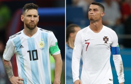 (COMBO) This combination of two files pictures created on June 30, 2018 shows Argentina's forward Lionel Messi (L) in Kazan on June 30, 2018 and Portugal's forward Cristiano Ronaldo in Sochi on June 30, 2018. / AFP PHOTO / Roman KRUCHININ AND Adrian DENNIS