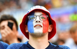 A France fan cheers before the Russia 2018 World Cup round of 16 football match between France and Argentina at the Kazan Arena in Kazan on June 30, 2018. / AFP PHOTO / Luis Acosta /