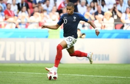 France's forward Kylian Mbappe scores their fourth goal during the Russia 2018 World Cup round of 16 football match between France and Argentina at the Kazan Arena in Kazan on June 30, 2018. / AFP PHOTO / FRANCK FIFE /