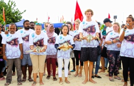 UNDP Resident Representative to the Maldives, Ms. Shoko Noda joined in releasing rehabilitated turtles back to the sea. PHOTO: HAWWA AMAANY ABDULLA / THE EDITION