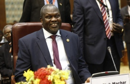 (FILES) In this file photo taken on June 25, 2018 South Sudanese opposition leader Riek Machar participates in the second round of talks aimed at ending South Sudan's four-and-a-half year brutal civil war, in Khartoum.  Machar, South Sudan rebel leader, is to be reinstated as vice president as South Sudan's warring leaders agreed to a power-sharing deal in Uganda, Sudan's foreign minister said, AFP reported on July 7, 2018. / AFP PHOTO / ASHRAF SHAZLY