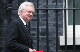 (FILES) This June 12, 2018 file photo shows Britain's Secretary of State for Exiting the European Union (Brexit Minister) David Davis leaving 10 Downing Street in central London after attending the weekly cabinet meeting.  Britain's Brexit minister David Davis has resigned two days after the cabinet approved a plan to keep strong economic ties with the European Union after leaving the bloc, British media reported on Sunday, July 8, 2018. Davis, who was appointed two years ago to head up the newly-created Department for Exiting the European Union, had reportedly threatened to quit several times over Prime Minister Theresa May's stance in Brexit talks.  / AFP PHOTO / Daniel LEAL-OLIVAS