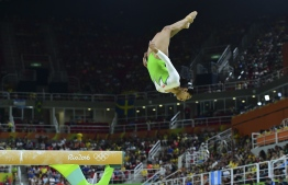 (FILES) In this file photo taken on August 7, 2016 India's Dipa Karmakar competes in the qualifying for the women's Beam event of the Artistic Gymnastics at the Olympic Arena during the Rio 2016 Olympic Games in Rio de Janeiro. Prime Minister Narendra Modi led the tributes July 9 for woman gymnast Dipa Karmakar who bagged India's first ever gold medal in a global gymnastic event in Turkey.  / AFP PHOTO / EMMANUEL DUNAND