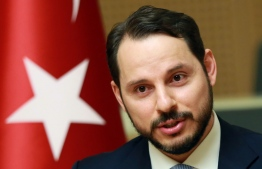 (FILES) In this file photo taken on July 27, 2016 Turkish Minister of Energy Berat Albayrak addresses the media in Ankara. President Recep Tayyip Erdogan on July 9, 2018 took on greater powers than any Turkish leader for decades as he was sworn in for a second presidential term, naming his son-in-law Berat Albayrak, 40, to the key post of finance minister in a revamped cabinet.  / AFP PHOTO / ADEM ALTAN