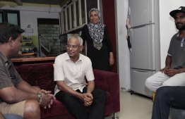Ibu meeting with a family during Hulumale door-to-door campaigns. PHOTO: MDP