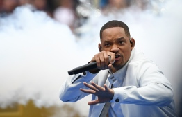 US actor Will Smith performs during the closing ceremony of the Russia 2018 World Cup ahead of the final football match between France and Croatia at the Luzhniki Stadium in Moscow on July 15, 2018. / AFP PHOTO / FRANCK FIFE /