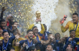 France's goalkeeper Hugo Lloris and his teammates celebrate with the World Cup trophy after the Russia 2018 World Cup final football match between France and Croatia at the Luzhniki Stadium in Moscow on July 15, 2018.  Odd ANDERSEN / AFP