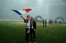 France's coach Didier Deschamps celebrates with his son Dylan after the Russia 2018 World Cup final football match between France and Croatia at the Luzhniki Stadium in Moscow on July 15, 2018.  Odd ANDERSEN / AFP