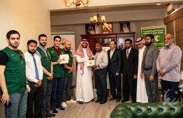 Islamic Affairs Minister Dr. Ahmed Ziyad Baqir accepts Saudi Arabia's donation of 50 tonnes of dates to the Maldives at a ceremony held at the Embassy of Saudi Arabia on July 16, 2018.