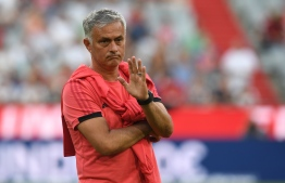 Manchester United's Portuguese manager Jose Mourinho gestures prior to the pre-season friendly football match between FC Bayern Munich and Manchester United at the Allianz Arena in Munich, southern Germany on August 5, 2018. / AFP PHOTO / Christof STACHE