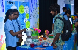 Students from Jamaaluddin School at their 'Think Smart, Think Green, Recycle' stall,  explaining the process of recycling paper and creating objects through reusing a common resource as paper, at the Farukoe Expo. PHOTO: HUSSAIN WAHEED/THE EDITION