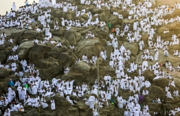 Muslim pilgrims gather on Mount Arafat, also known as Jabal al-Rahma (Mount of Mercy), southeast of the Saudi holy city of Mecca, on Arafat Day which is the climax of the Hajj pilgrimage early on August 20, 2018. Arafat is the site where Muslims believe the Prophet Mohammed gave his last sermon about 14 centuries ago after leading his followers on the pilgrimage. PHOTO: AHMAD AL-RUBAYE / AFP