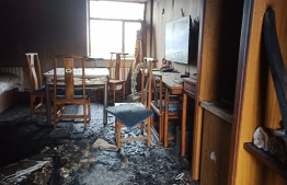 A view of a room after a fire at a hotel in Harbin, China's northeastern Heilongjiang province, on August 25, 2018.  A fire early August 25 at a hotel in China has left at least 18 people dead, according to an initial death toll given by state media. / AFP PHOTO / STR /