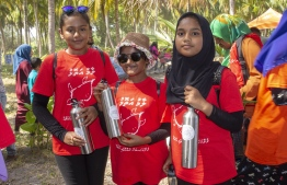 September 1, 2018, L. Maabaidhoo: Students show off the reusable water bottles they received from Six Senses Laamu at the Laamu Turtle Festival 2018. PHOTO: HAWWA AMAANY ABDULLA / THE EDITION