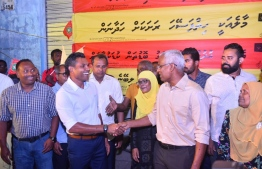 """Opposition coalition's presidential candidate Ibrahim Mohamed Solih (Ibu) (R) shakes hands with his running mate Faisal Naseem at the inauguration of the new MDP hub """"Maafolhey Jagaha"""" in Maafannu ward, Male City. PHOTO: AHMED NISHAATH/MIHAARU"""