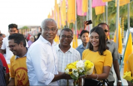 Opposition coalition's presidential candidate Ibrahim Mohamed Solih (Ibu) is warmly received during his campaign stop at N.Velidhoo. PHOTO/MDP