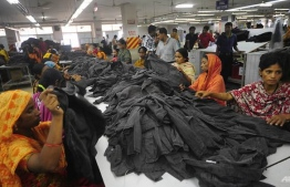 Bangladeshi workers sorting out garments in a factor in Ashulia, a suburban area near the capital of Dhaka. (Photo: AFP)
