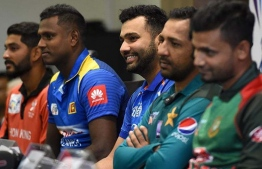 Indian cricket team captain Rohit Sharma (C) speaks during an Asia Cup press conference as Hong Kong cricket team captain Anshuman Rath (L), Sri Lankan cricket team captain Angelo Mathews (2L), Pakistan cricket captain Sarfraz Ahmed (2R) and Bangladesh cricket captain Mashrafe Mortaza (R) look on at the Dubai International Cricket Stadium in Dubai on September 14, 2018, ahead of the start of the 2018 Asia Cup cricket tournament.  ISHARA S. KODIKARA / AFP