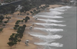 Large waves hit Repulse Bay beach after the hoisting of Signal 9 warning as super Typhoon Mangkhut starts to slam Hong Kong on September 16, 2018. Super Typhoon Mangkhut has smashed through the Philippines, as the biggest storm to hit the region this year claimed the lives of its first victims and forced tens of thousands to flee their homes.  / AFP PHOTO / Mark RALSTON