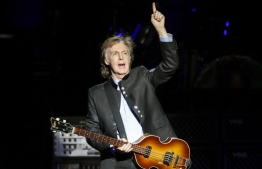 (FILES) In this file photo taken on July 26, 2017 Sir Paul McCartney performs in concert during his One on One tour at Hollywood Casino Amphitheatre in Tinley Park, Illinois. / AFP PHOTO / Kamil Krzaczynski