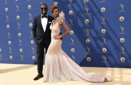 Lead actor in a drama series and guest actor in a comedy series nominee Sterling K. Brown and his wife Ryan Michelle Bathe arrive for the 70th Emmy Awards at the Microsoft Theatre in Los Angeles, California on September 17, 2018.  / AFP PHOTO / VALERIE MACON