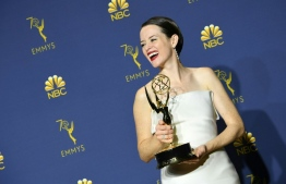Lead actress in a drama series winner Claire Foy poses with her Emmy during the 70th Emmy Awards at the Microsoft Theatre in Los Angeles, California on September 17, 2018. / AFP PHOTO / VALERIE MACON