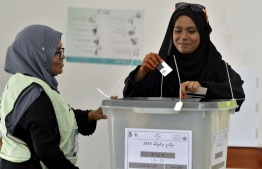 September 23, 2018: A woman casts her ballot in the Presidential Elections 2018. PHOTO/MIHAARU