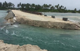 The causeway between Hoadedhdhoo and Madaveli, broken up by the residents of the former over flooding caused due to lack of proper water flow between the islands. PHOTO/FACEBOOK