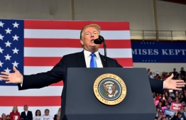 """US President Donald Trump speaks during a """"Make America Great Again"""" rally at the Eastern Kentucky University, in Richmond, Kentucky, on October 13, 2018. (Photo by Nicholas Kamm / AFP)"""