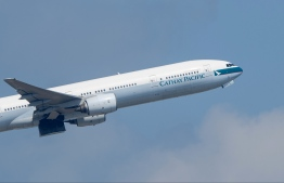 A Cathay Pacific passenger jet takes off from Hong Kong International Airport. PHOTO: ANTHONY WALLACE / AFP