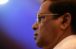 "(FILES) In this file photo taken on October 11, 2018, Sri Lankan President Maithripala Sirisena looks on during the opening of the seminar ""The Indian Ocean: Defining our Future"" in Colombo. - President Maithripala Sirisena on October 26 sacked his Prime Minister Ranil Wickremesinghe and appointed former president Mahinda Rajapakse as the new premier, the president's office said. (Photo by ISHARA S. KODIKARA / AFP)"