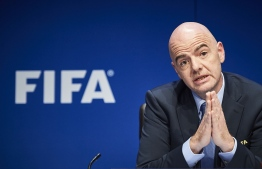 (FILES) In this file photo taken on March 18, 2016 FIFA President Gianni Infantino gives a press conference following an executive meeting of the world football governing body at its headquarters in Zurich. - Infantino will attend the FIFA council opening in Kigali on October 26, 2018. (Photo by MICHAEL BUHOLZER / AFP)