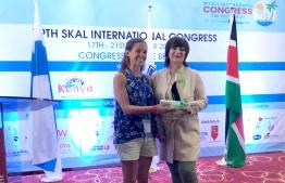 Biologist Jenni Choma accepts the Marine Conservation award on behalf of Six Senses Laamu at the 79th Skål World Congress in Mombasa, Kenya. PHOTO/SIX SENSES LAAMU
