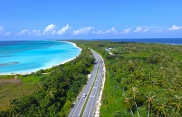 Aerial view of Laamu Link Road, bordered on either side by lush vegetation that gives way to glorious white sands and the endless blue of the ocean. PHOTO/REVERIES DIVING VILLAGE
