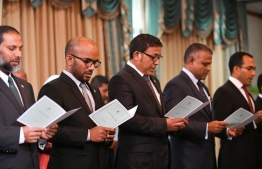 Members of the new cabinet taking the oath of office. / PHOTO: MIHAARU