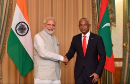 President Ibrahim Mohamed Solih (R) with Indian Prime Minister Narendra Modi during the latter's trip to Maldives. PHOTO: HUSSAIN WAHEED/MIHAARU