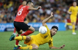 Australia's Massimo Luongo (R) is tackled by South Korea's Moon Seon-min during the international friendly football match between Australia and South Korea in Brisbane on November 17, 2018. (Photo by Tertius PICKARD / AFP) /