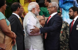This handout photograph taken and released by India's Press Information Bureau (PIB) on November 17, 2018 shows new Maldives President Ibrahim Mohamed Solih embracing Indian Prime Minister Narendra Modi during Solih's presidential inauguration in Male, Maldives. - Ibrahim Mohamed Solih was inaugurated November 17 as the new president of the Maldives after the opposition united to dislodge pro-China strongman leader Abdulla Yameen in September elections. (Photo by Handout / PIB / AFP) /