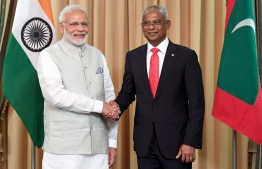 President Ibrahim Mohamed Solih (R) shaking hands with Indian Prime Minister Narendra Modi during the former's presidential inauguration on November 17, 2018. (Photo by Handout / PIB / AFP) /